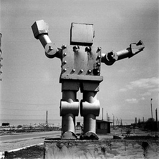 Rena Effendi Robot in front of a Soviet Factory