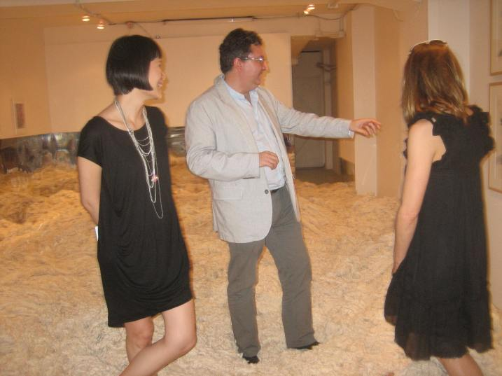Alvaro Rodriguez Fominaya shows visitors around at Surasi Kulsowong's Golden Fortune show