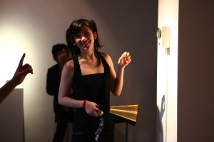 Another of the 'Three Beauties', Xiao Mi, with Xin Yunpeng's Doorbell (2009) installation - the 'squawk box'
