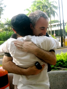 Gao (in white) hugging a participant outside the Hong Kong Arts Center in late July, 2009.