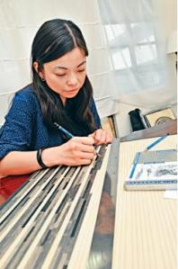 Artist Phoebe Hui at work in her studio