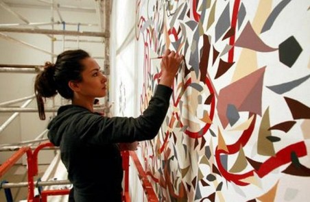 Shahzia Sikander working on a mural in the USA.