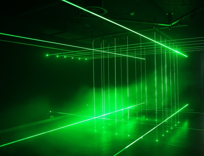 "Li Hui says about his work 'Cage': ""There are two cages inside the work made of laser beams. Laser beams are special in a way that they look tangible while in reality they are not. The two cages appear alternatively so that a group of people who find themselves 'trapped' in the cage in one moment would suddenly find themselves outside the cage in the next. This work brings out the contrast between reality and illusion."" 'Cage' (each 200 x 200 cm; height variable) is made of laser lights, mirrors and iron. Image courtesy of Ministry of Art."