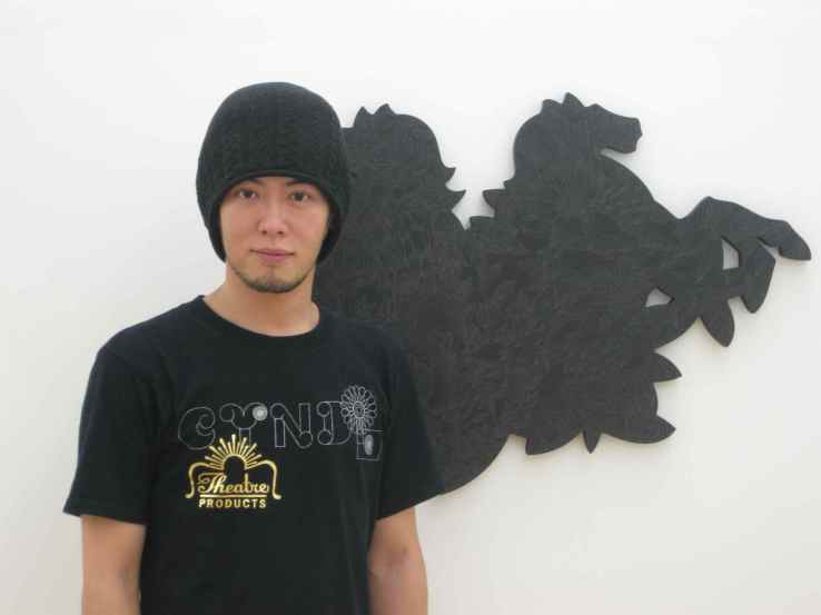 Artist Hiroshige Fukuhara next to his piece, 'The Night' at his latest solo exhibition at Ai Kowada Gallery in Japan. Image property of Art Radar Asia.