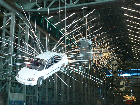 Cai Guo-Qiang's 'Inopportune: Stage One' (2004) is a colossal installation made with nine cars and sequenced multichannel light tubes which create an impression of a series of cars exploding and rotating through space.