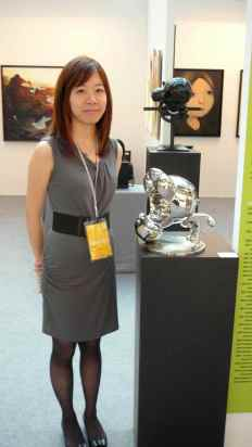 Joanna Li, Fish Art Center, beside Huang Poren's stainless steel sculpture 'What the heck!'. Image property of Art Radar Asia.